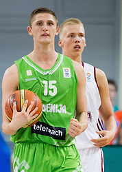 Gezim Morina of Slovenia and Janis Berzins of Latvia during basketball match between National teams of Latvia and Slovenia in Qualifying Round of U20 Men European Championship Slovenia 2012, on July 16, 2012 in Domzale, Slovenia. Slovenia defeated Latvia 69-62. (Photo by Vid Ponikvar / Sportida.com)