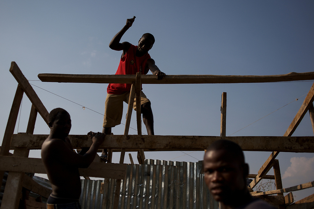 Burundian university students, seeking shelter outside the US embassy in Bujumbura, build toilets and showers in the yard of a vacant building close by. The students moved to the area in early May because, they claim, the US authorities ensure their security, after their university was closed amid anti-government protests. The government closed the university at the end of April, citing ìinsecurityî.