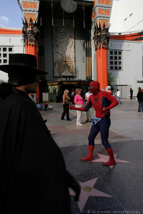 Impersonators in frond of the Chinese theatre.