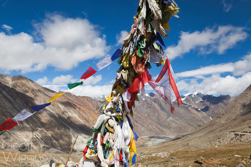 Buddhist prayer flags at the Pensi-la (4,400 m) (14,450 ft) mountain-pass, in Zanskar, northern India