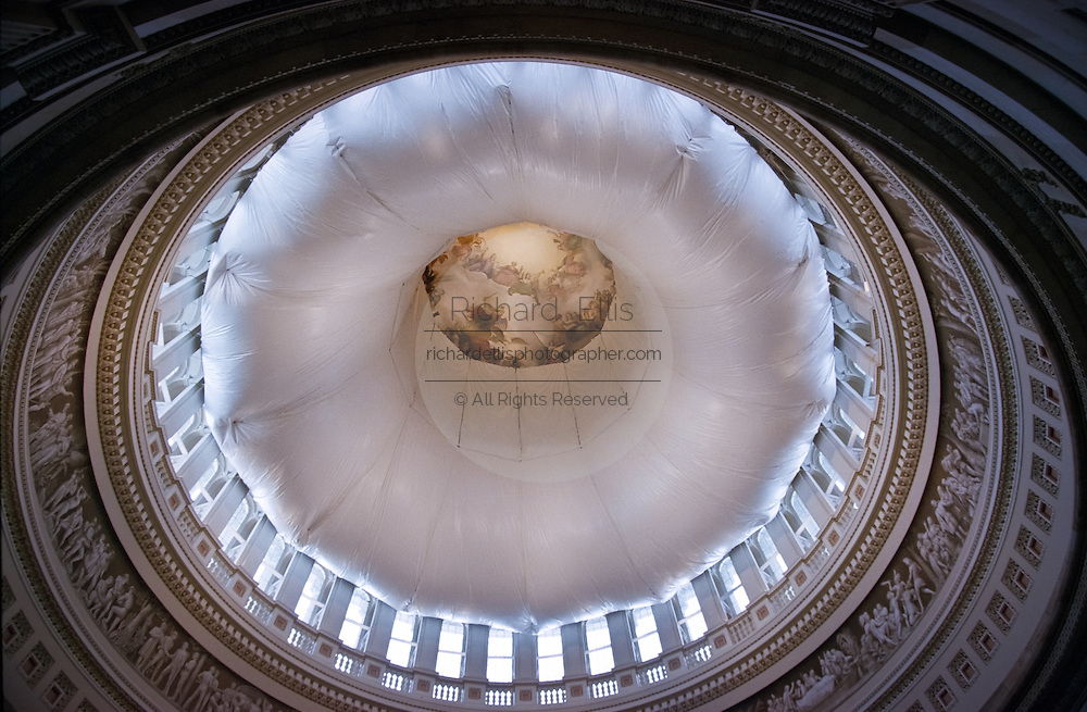 A construction tarp looking like a giant donut hangs 180 feet above the rotunda of the US Capitol dome during renovation work June 16, 1999 in Washington, DC. The dome, finished in 1866, is undergoing rehabilitation and will be completed in 2003.