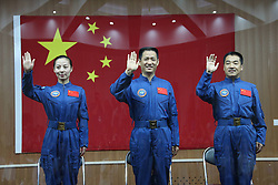 59797596<br /> The three astronauts of the Shenzhou-10 manned spacecraft mission, Nie Haisheng (C), Zhang Xiaoguang (R) and Wang Yaping, meet the media at the Jiuquan Satellite Launch Center in Jiuquan, northwest China s Gansu Province, June 10, 2013. The Shenzhou-10 manned spacecraft will be launched at the Jiuquan Satellite Launch Center at 5:38 p.m. Beijing Time (0938 GMT) June 11.<br /> UK ONLY