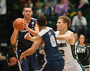 Utah State center Matt Lopez (4) looks to pass to guard Marcel Davis (0) during the second half of the NCAA basketball game between UVU and Utah State in the UCCU center in Orem, Saturday, Dec. 15, 2012.