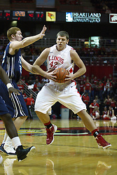 03 December 2011:  Nate Anderson defends jordan Threloff during an NCAA mens basketball game where the University of North Carolina at Wilmington Seahawks defeated the Illinois State Redbirds 63-54 inside Redbird Arena, Normal IL