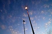 Parking lot lights at dusk.