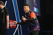 Paul Lim beats Kai Fan Leung in the preliminary round and celebrates during the William Hill PDC World Darts Championship at Alexandra Palace, London, United Kingdom on 18 December 2017. Photo by Shane Healey.