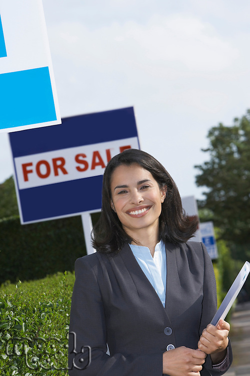 Smiling Real Estate Agent Outdoors