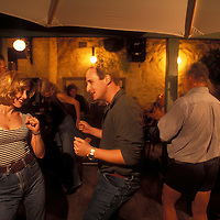 Australia, Western Australia, (MR) Louise and Nicholas Law dance at Norfolk Hotel pub in Freemantle near Perth