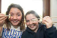 Sarah McGaugh and Jasmin Browne from the Claddagh national school in Knocknacarra at the Galway education centre, for a Chinese experience  . Photo:Andrew Downes.]