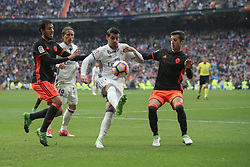 April 29, 2017 - Madrid, Spain - MADRID, SPAIN. APRIL 29th, 2017 - Alvaro Morata against Valencia defenders previous to Marcelo goal. La Liga Santander matchday 35 game. Real Madrid defeated 2-1 Valencia with goals scored by Cristiano Ronaldo (26th minute) and Marcelo (86th minute). Parejo (82nd minute) scored for Valencia. Santiago Bernabeu Stadium. Photo by Antonio Pozo | PHOTO MEDIA EXPRESS (Credit Image: © Antonio Pozo/VW Pics via ZUMA Wire/ZUMAPRESS.com)