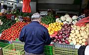 jewish man at vegetables stalll haifa israel