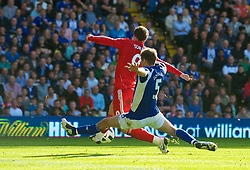 BIRMINGHAM, ENGLAND - Sunday, September 12, 2010: Liverpool's Fernando Torres is brought down in the penalty area by Birmingham City's Roger Johnson during the Premiership match at St Andrews. (Photo by David Rawcliffe/Propaganda)