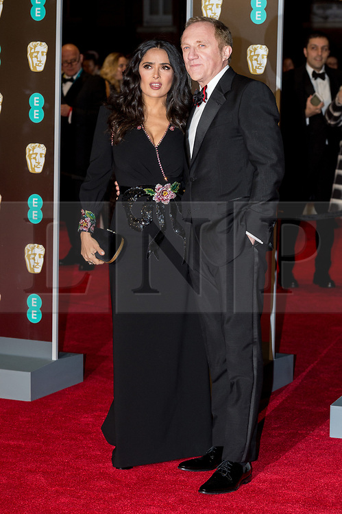 © Licensed to London News Pictures. 18/02/2018. SALMA HAYEK and FRANCOIS-HENRI PINAULT arrives on the red carpet for the EE British Academy Film Awards 2018, held at the Royal Albert Hall, London, UK. Photo credit: Ray Tang/LNP