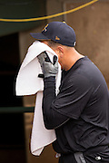 New York Yankees Alex Rodriguez rests after batting practice before appearing in the first game since hip surgery with the minor league Charleston RiverDogs at Joseph P. Riley Jr. Stadium July 2, 2013 in Charleston, South Carolina.