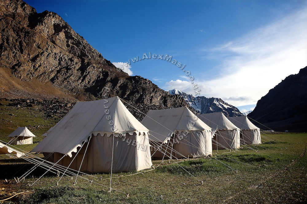 A tent camp where travellers can sleep during the 479 Km trip, which takes on verge 2 days to complete, is photographed along the Leh-Manali Highway...The Leh-Manali Highway is the main road connection between the remote mountainous region of Ladhak, with capital in Leh (3300m), and Manali, HP, a famous hill station 600 km north of New Delhi. Open only four months a year, it is the second-highest motorable road in the world crossing passes up to 5300 meters. It was constructed by the Indian Army in order to develop the surrounding areas as well as monitoring the nearby borders with Kashmir and China. Due to its beauty and increased accessibility, the road to Leh and Ladhak has recently become a must-see destination for local and international tourists leaving the scorching Indian plains..