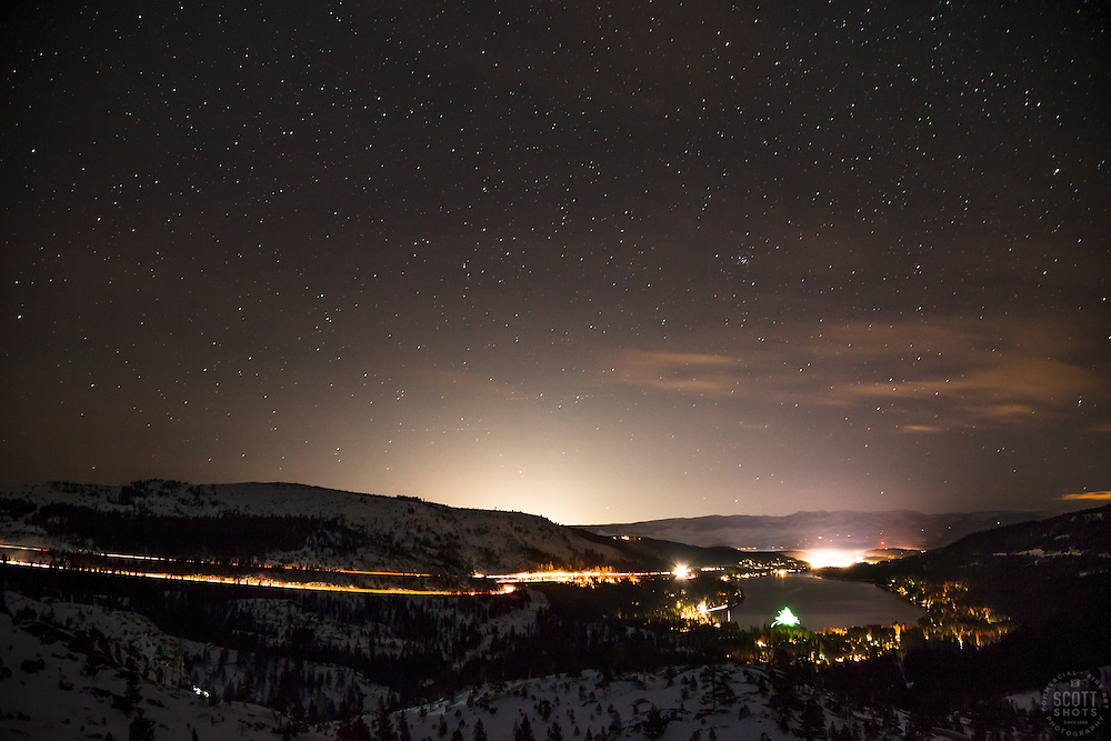 """Donner Lake at Night 2"" - Photograph of a starry night, fireworks, Donner Lake, and Truckee, California shot at night."