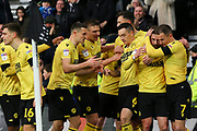 Millwall players celebrate after scoring during the EFL Sky Bet Championship match between Derby County and Millwall at the Pride Park, Derby, England on 14 December 2019.