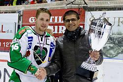Ales Music (HDD Tilia Olimpija, #16) with medal and Matjaz Rakovec, president of HZS, after ice-hockey match between HK Acroni Jesenice and HDD Tilia Olimpija in fourth game of Final at Slovenian National League, on April 2, 2012 at Dvorana Podmezaklja, Jesenice, Slovenia. HDD Tilia Olimpija won 5:2 and become national champions in season 2011/12. (Photo By Matic Klansek Velej / Sportida.com)