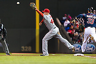 Justin Morneau #33 of the Minnesota Twins is safe at 1st base when Mark Trumbo #44 of the Los Angeles Angels can't keep his foot on the base to make the catch on April 16, 2013 at Target Field in Minneapolis, Minnesota.  The Twins defeated the Angels 8 to 6.  Photo: Ben Krause
