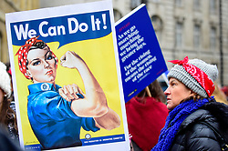 """© Licensed to London News Pictures. 19/01/2019. LONDON, UK. A woman holds up a We Can Do It sign joining thousands of participants in the Women's March in the capital, one of 30 such worldwide marches protesting against violence against women and the negative impact of austerity policies.  London's theme this year is """"Bread and Roses"""", honouring Polish-American suffragette Rose Schneiderman who, in 1911 said """"The worker must have bread but she must have roses too"""", in response to a factory fire where 146 mainly female garment workers died.  Photo credit: Stephen Chung/LNP"""