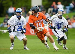 Virginia midfielder Garett Ince (15) runs past Duke midfielder Mike Catalino (29) and Duke midfielder Sam Payton (32).  The #2 ranked Duke Blue Devils defeated the #3 ranked Virginia Cavaliers 11-9 in the finals of the Men's 2008 Atlantic Coast Conference tournament at the University of Virginia's Klockner Stadium in Charlottesville, VA on April 27, 2008.