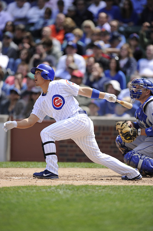 CHICAGO - MAY  04:  Darwin Barney #15 of the Chicago Cubs bats against the Los Angeles Dodgers on May 4, 2012 at Wrigley Field in Chicago, Illinois.  The Cubs defeated the Dodgers 5-4.  (Photo by Ron Vesely)   Subject:  Darwin Barney