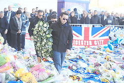 Aiyawatt Srivaddhanaprabha son of Leicester Chairman lays a wreath in memory of his father, Vichai Srivaddhanaprabha, was among those to have tragically lost their lives on Saturday evening when a helicopter carrying him and four other people crashed outside King Power Stadium.
