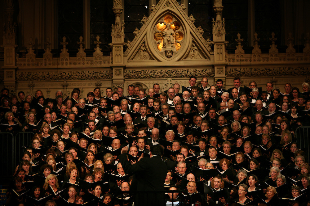 Conductor Julian Wachner with the six choirs during Remember to Love: Let Us Love One Another With A Sincere Heart, an observation of the 10th Anniversary of September 11 at Trinity Church in Manhattan, NY on September 09, 2011. The six choirs performing include NYC Master Chorale, Trinity Choir, Young People's Chorus of New York City, The Washington Chorus, The Bach Choir of Bethlehem and The Copley Singers.