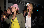 Lauren Kirkwood ( black fur)  and Chloe Bailey (pink hat), Xelibri mobile phone launch, Old Billingsgate Market, 15 February 2003. © Copyright Photograph by Dafydd Jones 66 Stockwell Park Rd. London SW9 0DA Tel 020 7733 0108 www.dafjones.com