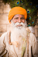 India, Jaisalmer. A portrait of Mr Kalicharan Singh, a famous peacock feather seller.
