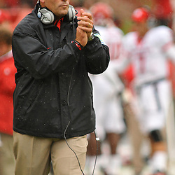 Sep 26, 2009; College Park, MD, USA; Rutgers head coach Greg Schiano applauds a successful extra point attempt during the first half of Rutgers' 34-13 victory over Maryland in NCAA college football at Byrd Stadium.