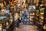 Portobello Road Feature:<br /> Portobello Road is traditionally known for it's antiques, however the influx of the affluent young and the rise of the fashion scene has started to send the local shops in a slightly different direction. Although the arrival of big brand chain stores have started to threaten the local antique shops, the ones that remain still carry an essence of cutting edge mixed with vintage artefacts - prolonging the existence of Portobello Road's unique dynamic. <br /> Pictured: Sisters Victoria and Jessica Blake also known as The Jessie Western Sisters pose for a picture in their shop 'Jessie Western'. The shop has been there for 14 years, yet they have been in business for 25. They support more than 4000 Native American Indian artists.<br /> Rick Findler / Story Picture Agency