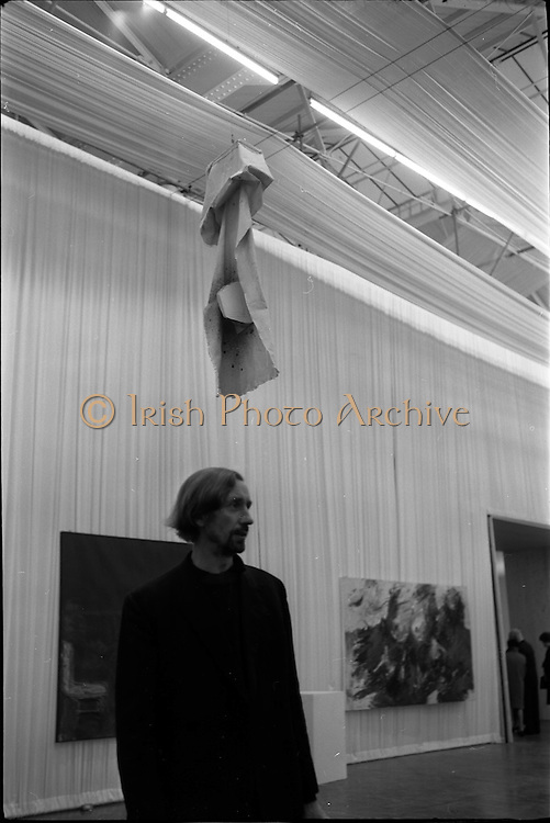 11/11/1967<br /> 11/11/1967<br /> 11 November 1967<br /> ROSC Art Exhibition 1967.<br /> John Latham standing under his exhibit Soft Skoob 1966 hung at the ROSC exhibition at the Royal Dublin Society, Dublin.