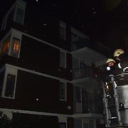 Stormschade Eek Huizen, dak flat los gewaaid, brandweer ladderwagen 751