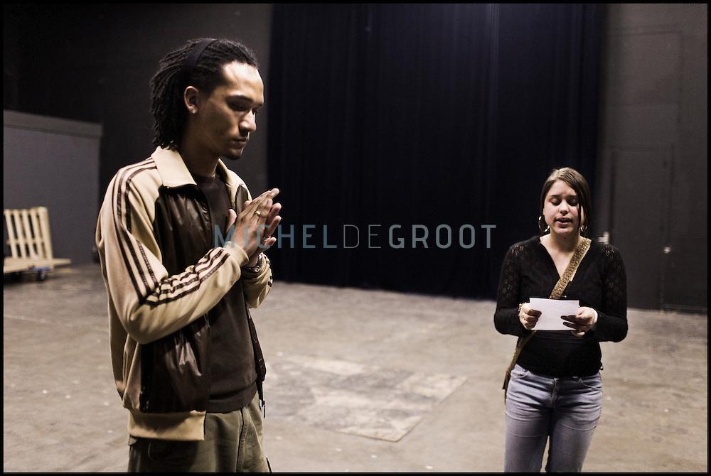 Professional rapper Marcelino Callias teaches rap at the Quadrate Hip Hop School in Arnhem in the Netherlands. At the Quadrate Hip Hop school young kids can take workshops in rap, hip hop, breakdance and DJ Spinning...In Arnhem is sinds januari 2006 een HipHopschool gevestigd. Op deze school kunnen jongeren van tussen de 10 en 25 jaar workshops volgen in Rap, R&B zang, Breakdance, HipHop dance en DJ Spinning. Dit iniatief is tot stand gekomen door een samenwerking van Stichting Interart en de Arnhemse Rapgroep 'Andere Gekte'.  Arnhem, THE NETHERLANDS - 21-04-2006: