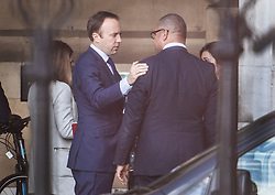 © Licensed to London News Pictures. 17/06/2019. London, UK. Health Secretary Matt Hancock touches Conservative party deputy chairman James Cleverly on the shoulder as they talk in Parliament ahead of a leadership hustings. Boris Johnson has cemented his position as favourite to become the next Prime Minster after winning a landslide in the first round of the conservative party's leadership race. Photo credit: Ben Cawthra/LNP