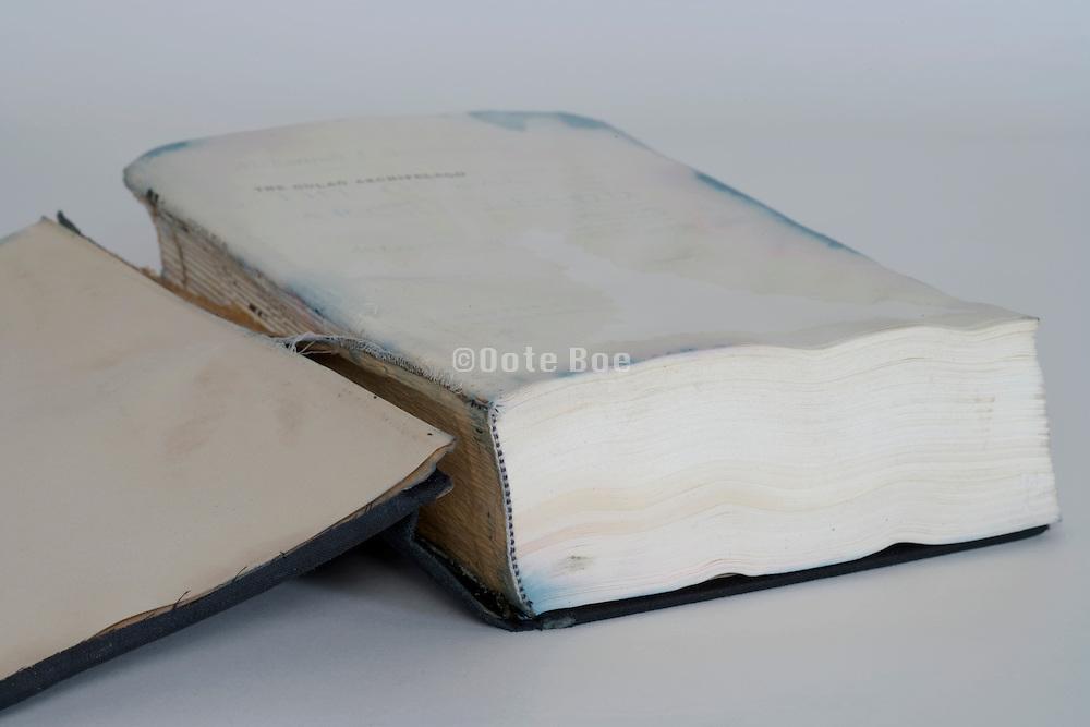 open hardcover book with broken spine