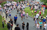Middletown, New York - Runners gather before the start of the 16th annual Ruthie Dino-Marshall 5K Run/Walk put on by the Middletown YMCA on Sunday, June 10, 2012. ©Tom Bushey / The Image Works