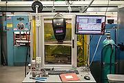 AUBURN, AL – NOVEMBER 20, 2016: A 3D printer in Dr. Lewis Payton's Design and Manufacturing Laboratory at Auburn University. The printer builds solid metal objects using a process coined Wir3D, an additive manufacturing technique comparable to MIG welding that continuously melts metal wire in an electric arc. The head that continuously feeds the wire is animated by a computer, on which the design is loaded. <br /> <br /> In much of the United States, global trade and technological innovation has failed to produce the prosperity hoped for by political and business leaders. Yet despite formidable economic challenges, some localities are flourishing. In Lee County, Ala., unemployment is below the national average despite the loss of thousands of manufacturing jobs, and the key to the county's resilience may be Auburn University, which provided a steady source of employment during recessions and helped draw new businesses to replace those that fled. CREDIT: Bob Miller for The Wall Street Journal<br /> [RESILIENT]