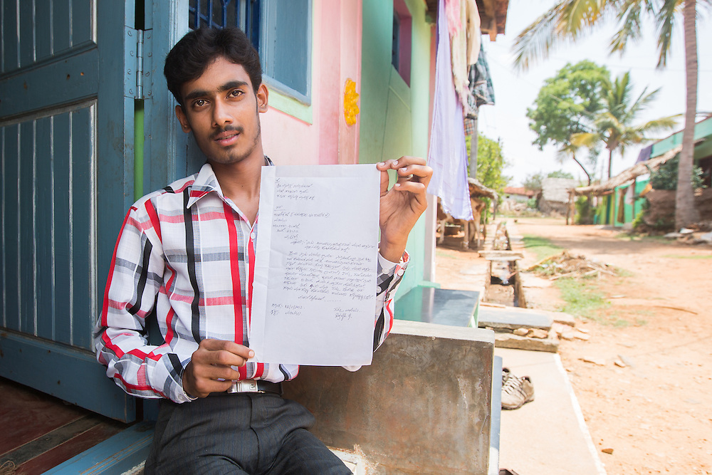 CAPTION: One of Mobility India's field staff alerted Rajesh to the fact that he could approach the office of the District Collector (DC) for a motorised tricycle. Here, he is showing a copy of the letter he wrote to the DC. Rajesh is keen to inspire other young people with disabilities to push for their rights in a similar way. LOCATION: Marialla (village), Kasaba (hobli), Chamrajnagar (district), Karnataka (state), India. INDIVIDUAL(S) PHOTOGRAPHED: Rajesh G.