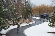 A biker rides through campus. (Photo by Rajah Bose)