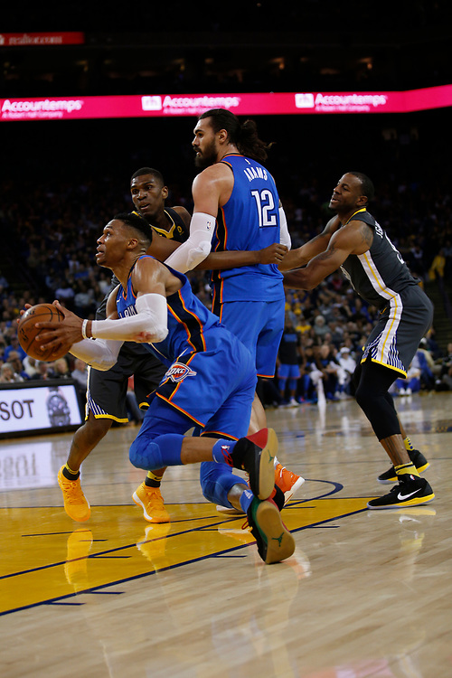 Oklahoma City Thunder guard Russell Westbrook (0) falls to the ground and the referee calls a foul against Golden State Warriors forward Kevin Durant (35) during the second half of an NBA game between the Warriors and Oklahoma City Thunder at Oracle Arena, Tuesday, Feb. 6, 2018, in Oakland, Calif. The Warriors lost 105-125.