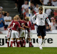 Fotball<br /> England 2005/2006<br /> Foto: SBI/Digitalsport<br /> NORWAY ONLY<br /> <br /> Danmark v England<br /> <br /> International Friendly. 17/08/2005.<br /> <br /> England captain David Beckham hangs his head in disappointment as Denmark celebrate in the background.