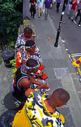 Young men sitting on a wall, Notting Hill Carnival, 1996