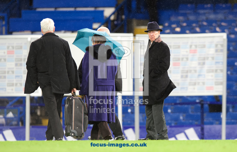 Sir Bobby Charlton (right) leaving the ground after the Barclays Premier League match at Stamford Bridge, London<br /> Picture by Alan Stanford/Focus Images Ltd +44 7915 056117<br /> 07/02/2016