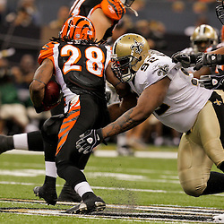 2009 August 14: New Orleans Saints defensive tackle Remi Ayodele (92) pursues Cincinnati Bengals running back Bernard Scott (28) during a preseason opener between the Cincinnati Bengals and the New Orleans Saints at the Louisiana Superdome in New Orleans, Louisiana.