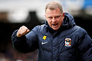 Coventry City manager Mark Robins celebrates after Coventry went ahead 0-1 during the EFL Sky Bet League 1 match between Peterborough United and Coventry City at London Road, Peterborough, England on 16 March 2019.