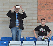 a port vale fan captures the moment before the Sky Bet League 1 match between Bury and Port Vale at Gigg Lane, Bury, England on 19 September 2015. Photo by Mark Pollitt.