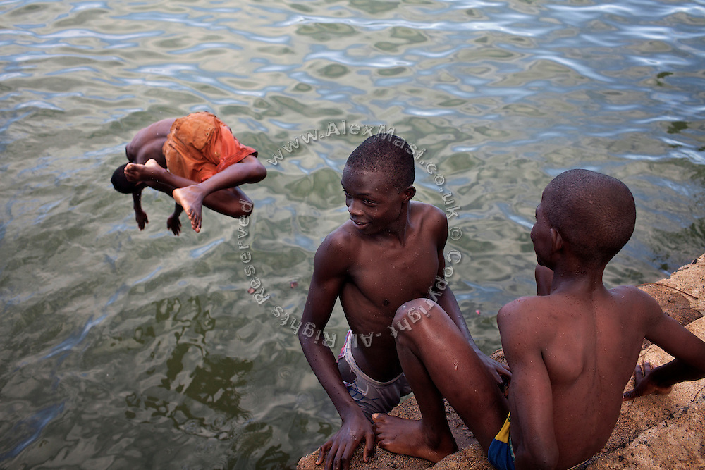 Youngsters are diving into the sea near Claudio Corallo's home on the island of Sao Tome, Sao Tome and Principe, (STP) a former Portuguese colony in the Gulf of Guinea, West Africa.