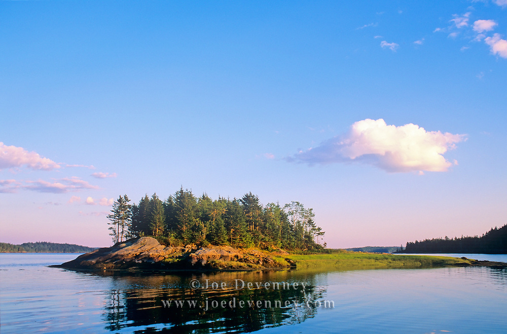 Island and clouds at low tide. Cobscook Bay State Park. Edmunds, Maine